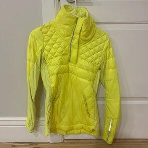 Bright yellow Lululemon pullover coat